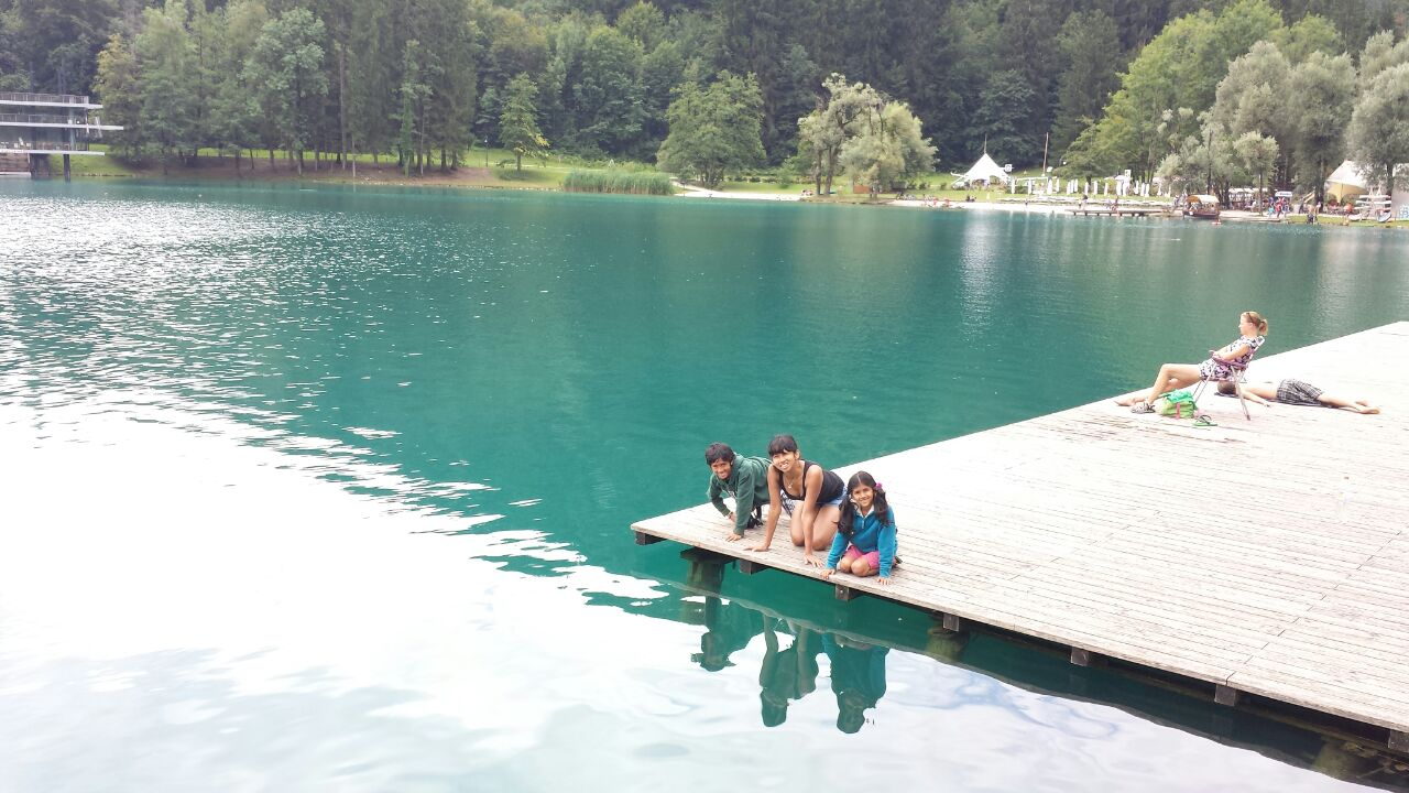 Swimming In Emerald Green Waters Of Lake Bled Slovenia